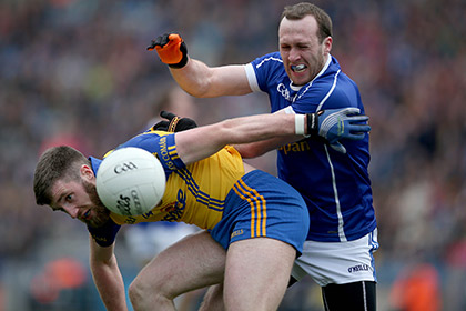 Roscommon's Cathal Cregg with Fergal Flanagan of Cavan. INPHO