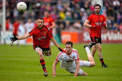 Tyrone's Colm Cavanagh with Down's Conor Laverty. INPHO