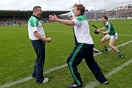 imerick's manager TJ Ryan celebrates with selector Paul Beary. INPHO