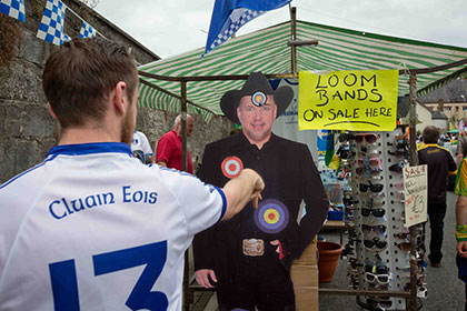 Ciaran Morgan from Clones throws darts at a cardboard cutout of Garth Brooks before the Ulster SFC final. INPHO