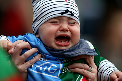 Can't believe the replays not in Croke Park. A young Mayo / Dublin supporter at yesterday's semi final. INPHO