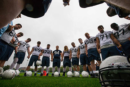 Penn State players say a prayer after training in UCD. INPHO