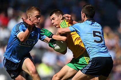 Dublin's Andrew Foley and Andrew McGowan with Michael Carroll of Donegal during the All Ireland MFC semi final. INPHO