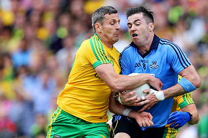 Dublin's Michael Darragh Macauley and Christy Toye of Donegal. INPHO