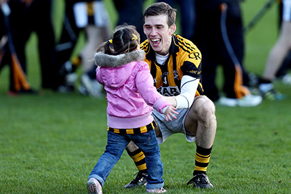 Paul Hughes of Crossmaglen celebrates with his neice Eva Rose at the end of the game. INPHO