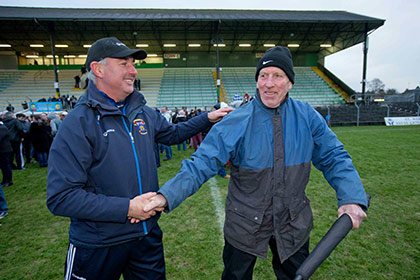St Vincent's manager Tommy Conroy is congratulated by Brian Mullins at Pairc Tailteann. INPHO