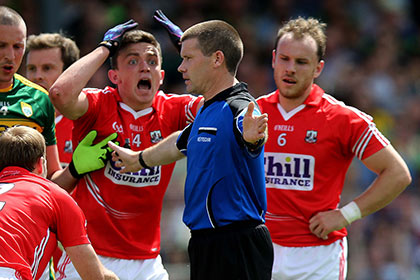 Mark Collins of Cork reacts as referee Padraig Hughes award's a penalty against him. INPHO