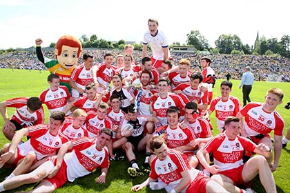 Derry celebrate their Ulster MFC Final win over Cavan at Clones. INPHO