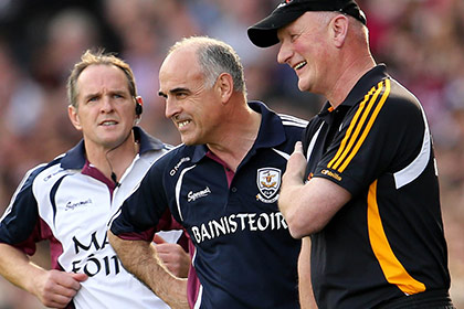 Anthony Cunningham and Brian Cody share a joke on the sideline. INPHO