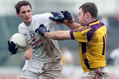 Kildare's Hugh Lynch with Paddy Byrne of Wexford during the O'Byrne Cup game at Newbridge. INPHO