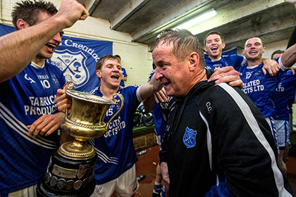 Cratloe manager Colm Collins celebrates with his team after the game with Padraic Collins. INPHO