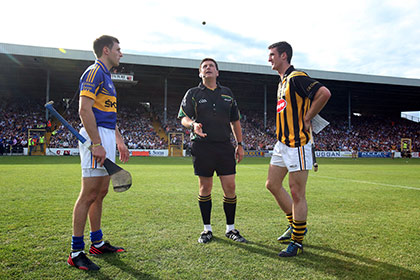 Captain's Colin Fennelly and Shane McGrath with referee Brian Gavin before then 2013 All Ireland qualifier at Nowlan Park. INPHO