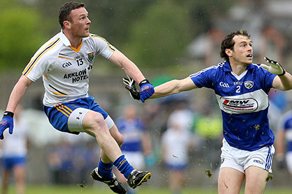 Leighton Glynn of Wicklow with Padraig McMahon of Laois. INPHO