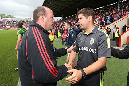Cork manager Brian Cuthbert and Kerry manager Eamonn Fitzmaurice shake hands after the game. INPHO