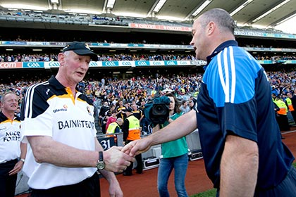 Anthony Daly and Brian Cody shake hands after the Leinster SHC final at Croke Park. INPHO
