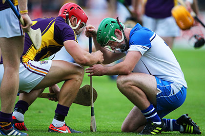 Wexford's Lee Chin consoles Gavin O'Brien of Waterford after the game. INPHO