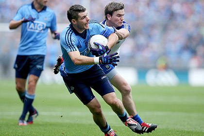 Kevin McManamon of Dublin with Dessie Mone of Monaghan. INPHO