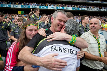 Donegal manager Jim McGuinness is congratulated by his brother Frank McGuinness and niece Orla McGuinness. INPHO