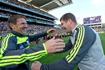 Kerry manager Eamonn Fitzmaurice celebrates with minor manager Jack O'Connor. INPHO