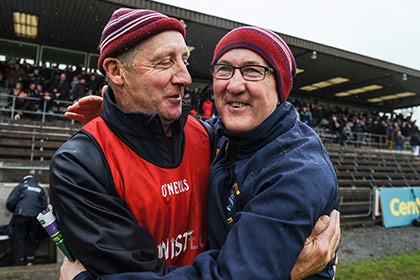 Westmeath manager Michael Ryan and coach Michael Walsh celebrate after beating Antrim in Cusack Park. INPHO