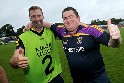 Wexford manager David Power and selector Mattie Forde celebrate at the final whistle. INPHO