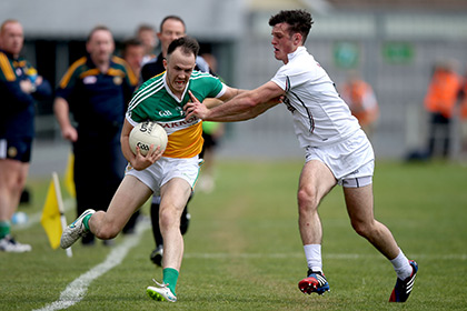 Offaly's Graham Guilfoyle with Eoin Doyle of Kildare during the Round 2A, qualifier at  O'Connor Park Offaly. INPHO