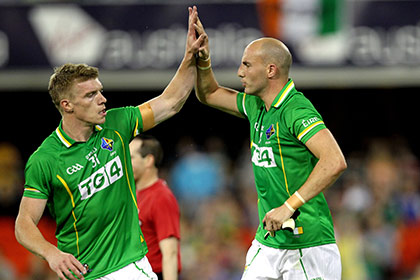 Tommy Walsh and Tadhg Kennelly celebrate a score for Ireland against Australia. INPHO