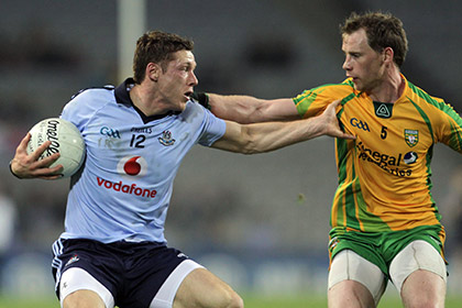 Dublin's Paul Flynn with Anthony Thompson of Donegal. INPHO