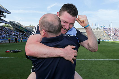 Dublin manager Anthony Daly celebrates with Niall Corcoran. INPHO