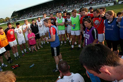 Kildare manager Kieran McGeeney with his team at St Conleth's Park Newbridge. INPHO