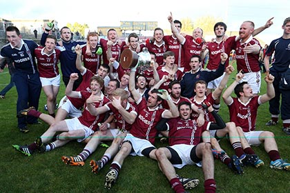 Slaughtneil players celebrate winning the Derry senior title. INPHO
