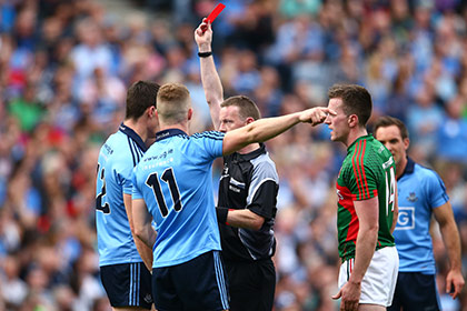 Referee Joe McQuillan shows Diarmuid Connolly of Dublin a red card. INPHO