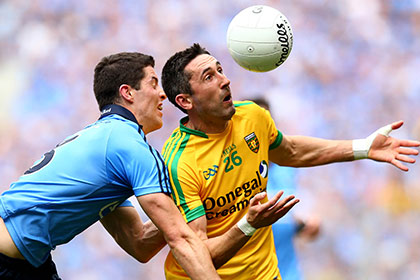 Dublin's Rory O'Carroll and Rory Kavanagh of Donegal. INPHO