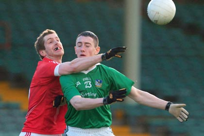 Limerick's Paidi Ahern is tackled by Richard O'Sullivan of Cork during the McGrath Cup Quarter-Final at Newcastlewest