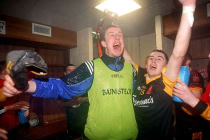 Ard Scoil Ris manager Niall Moran celebrates with his players in the dressing room after winning the Harty Cup.