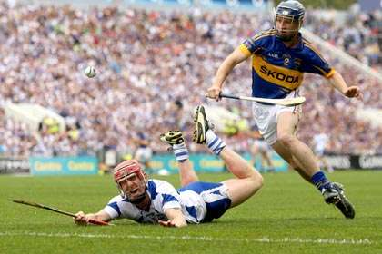 Waterford's John Mullane and Paddy Stapleton of Tipperary during the Munster SH final at Pairc Ui Chaoimh