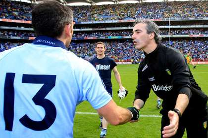Donegal manager Jim McGuinness congratulates Alan Brogan of Dublin after the game.