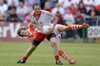 Armagh's Kevin Dyas and Tyrone's Ronan McNabb