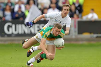 Offaly's Anton Sullivan with Ollie Lyons of Kildare ©INPHO