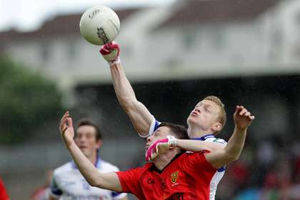 Monaghan's Colin Walshe breaks the ball against Down