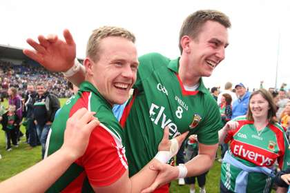 Mayo captain Andy Moran and Barry Moran celebrate ©INPHO/