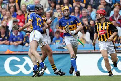 Lar Corbett chases around after Tommy Walsh. ©INPHO