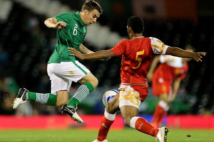 Ireland's Seamus Coleman and Mohammed Al Balushi of Oman
