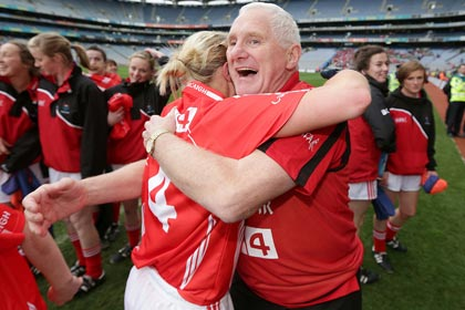 Cork's Deirdre O'Reilly celebrates with manager Eamonn Ryan after the All Ireland Final win over Kerry. INPHO