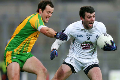Kildare's Padraig O'Neill and Michael Murphy of Donegal. INPHO