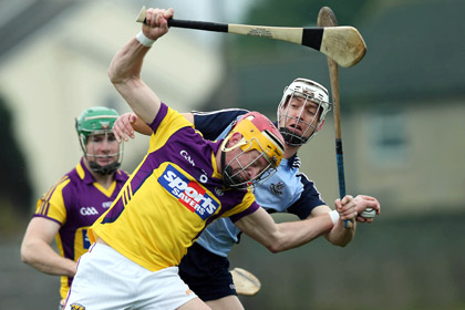 Andrew Shore of Wexford with Mark Schutte of Dublin during the Walsh Cup decider at Bellefield Enniscorthy. INPHO