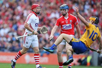 Cork goalkeeper Anthony Nash makes his way up the field to take a penalty as team mate Conor Lehane clears John Conlon of Clare out of the way.<br />&#169;INPHO/Cathal Noonan.