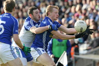 Scotstown&#39;s Kieran Hughes and Daniel McKinless of Ballinderry during the 2013 Ulster club SFC quarter-final.<br />&#169;INPHO/Presseye/Andrew Paton.