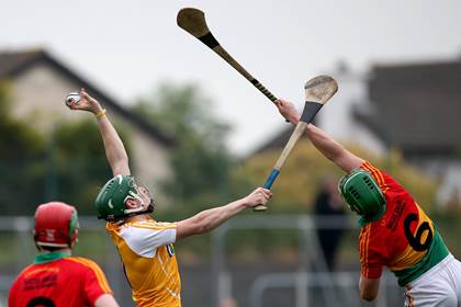 Carlow&#39;s David English and Paul Shiels of Antrim when both sides met in the 2014 Leinster SHC.<br />&#169;INPHO/Ryan Byrne.
