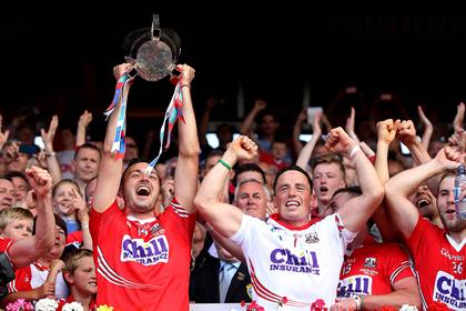 Cork's Pa Cronin and goalkeeper Anthony Nash celebrate lifting the Munster trophy ©INPHO/James Crombie